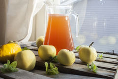 A can full of apple wine. Near apples, mint, lemon and lime Royalty Free Stock Photos