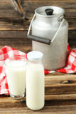 Can and glass of milk Royalty Free Stock Photos