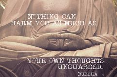 Can harm you Buddha. Nothing can harm you as much - famous Buddha quote printed on image of sculpture`s hands in peaceful position, original photo id 37965439 is Stock Photography