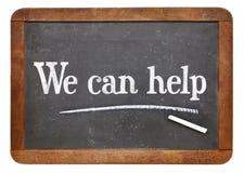 We can help blackboard sign Stock Photo