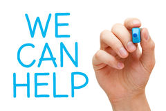 We Can Help. Hand writing We Can Help with blue marker on transparent wipe board Royalty Free Stock Photo