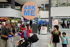 Can I Help You. SEPANG, MALAYSIA - MAY 10: Airport staff holding Ask Me signage to help passengers and visitors navigate the new low cost carrier terminal (KLIA2 stock photo