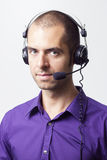 Can i help you?. Young man with headset in purple shirt. Waiting for call Stock Photos