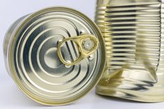 Can with meat dish on a white table. Canned food with a long she. Lf life. Light background royalty free stock image
