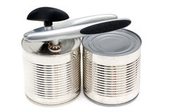 Can-opener on the cans Royalty Free Stock Image