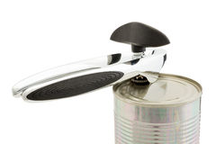 Can Opener on Lid on Unopened Can. Cutout of can opener locked in on lid of unopened can stock image