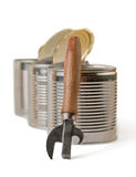 Can opener and  three brilliant tin cans. Royalty Free Stock Photography