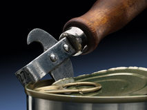 Can opener and tin. Royalty Free Stock Photos