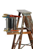 Can of paint and Brushes over Ladder Royalty Free Stock Images