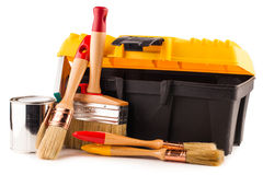 Can of paint with paintbrushes and toolbox Stock Photo