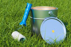 Can with paint and roller brush in the green grass, 3D rendering. Can with paint and roller brush in the green grass, 3D Royalty Free Stock Photography