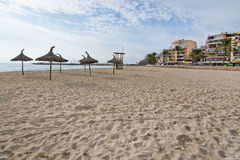 Can Pastilla view. CAN PASTILLA, MALLORCA, BALEARIC ISLANDS, SPAIN - DECEMBER 14, 2015: Can Pastilla view with hotels, restaurants and people biking along the Royalty Free Stock Image