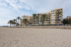 Can Pastilla view. CAN PASTILLA, MALLORCA, BALEARIC ISLANDS, SPAIN - DECEMBER 14, 2015: Can Pastilla view with hotels, restaurants and people biking along the Royalty Free Stock Images