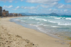 Can Picafort beach off season. CAN PICAFORT, MALLORCA, SPAIN - APRIL 20, 2015: Can Picafort beach off season on a sunny spring day on April 20, 2015 in Can Stock Photos