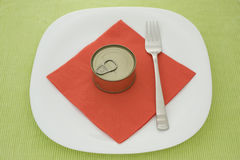 Can on plate Stock Photography
