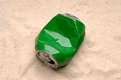 A can polluting the beach Royalty Free Stock Photos