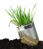 Can with recycling tag and growing grass Royalty Free Stock Image