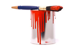 Can of red paint. And professional brush on a white stock photography