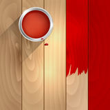 A can of red paint on a wooden background Royalty Free Stock Image