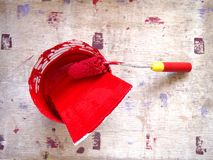 Can and roller brush with red paint Stock Photography