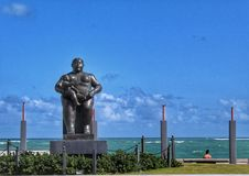 Statue by the ocean stock photography