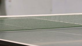 We can see a white ping pong ball travelling from one side of the table to another. Mens are playing table tennis stock video footage