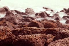 Can stones be a hindrance for water. Shot taken in mid day displaying a focused closeup view of big stones near sea beach royalty free stock images