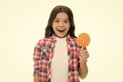 Can sugar make us happy. Girl cute smiling face holds sweet lollipop. Sweets in appropriate portions ok. Girl likes. Sweets as lollipop candy isolated white stock photography