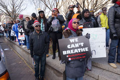 We Can't Breathe. Photo of protesters downtown at pennsylvania avenue in washington dc on 12/13/14.  This woman is displaying a sign that says we can't breathe Royalty Free Stock Images