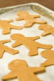 Can't catch me. Three rows of gingerbread men ready for the oven Royalty Free Stock Photo
