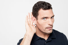 Can't hear clearly, eavesdropping. Royalty Free Stock Images