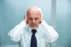 Can't hear (closed eyes) Stock Images