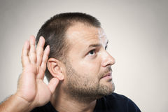 Can't hear you!. A man trying to hearing the sound around him - What did you say Royalty Free Stock Images