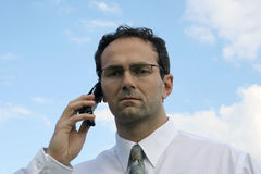 Can't hear you. Man and a cell phone Royalty Free Stock Image