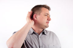 Can't hear you. Man wearing hearing aid trying to hear Stock Images