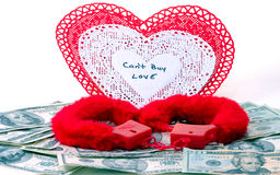 Can't By Love. Valentine's day concept that you Can't Buy Love Hearts, money and handcuffs Royalty Free Stock Image