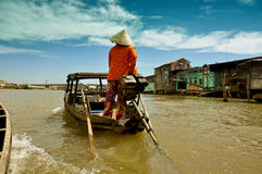 Mekong delta floating market, Vietnam. CAN THO - FEB 17: Unidentified Vietnamese vendor selling goods from boat at the Floating Market in Can Tho, Vietnam on Feb Royalty Free Stock Image
