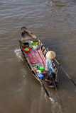 Can Tho Floating Market, Mekong Delta, Vietnam. Man in asian conical hat is floating down Mekong river on wooden boat, Can Tho Floating Market, Mekong Delta Royalty Free Stock Image