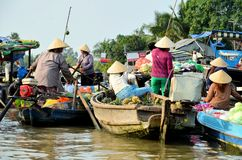 CAN THO, VIET NAM - MARCH 5 ,2015: Unidentified Vietnamese women on the Floating Market in Can Tho, Vietnam. Stock Photo