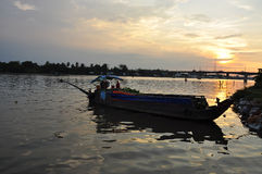 Can Tho, Vietnam. Boat on Mekong river by sunset Royalty Free Stock Photography