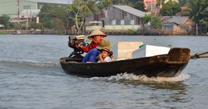 Can Tho, Vietnam - 5 March 2015: A family moving by rowing boat, the most common transportation mean of rural people in Mekong del Stock Images