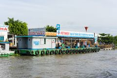 Can Tho, Vietnam - Nov 30, 2014: A floating mobile gasoline and oil station on Tien river, Mekong delta stock photos