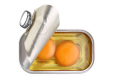 Can with two fresh raw eggs isolated. On white Royalty Free Stock Photo