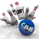 Can Vs Can't Bowling Balls Strike Overcoming Naysayers. A blue bowling ball with the word Can hits a strike against pins with the word Can't to illustrate Stock Image