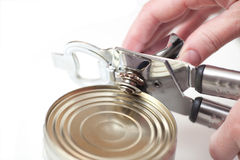 Can With Can Opener Hand Stock Photo