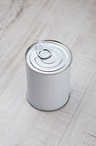 Can on wood floor Stock Image