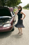 Can You Come Get Me?. A woman on a cell phone as if calling someone to come help her because her car has broken down Royalty Free Stock Image