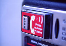 Can you hear me now?. Volume button of a payphone Royalty Free Stock Images
