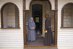 Cana Galilee Nun Monk. A nun and a monk are seen in a building at the Franciscan Church site at Kefer-Kenna near Nazareth, a site commemorating the water to wine Stock Images