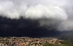 Cana of Galilee before the storm. Black storm cloud hanging over kfar Kana in Israel Royalty Free Stock Photo